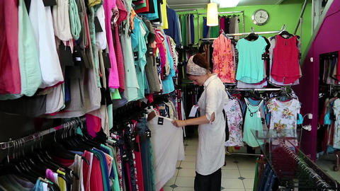 Woman in clothing store Footage