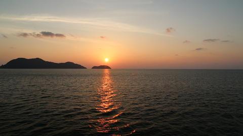 Sea, clouds, island, beautiful sunset Footage