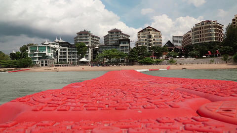 Buildings On The Shore Of Gulf Of Siam In Pattaya, Thailand stock footage