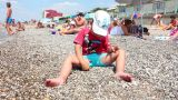 Child Playing On The Beach stock footage