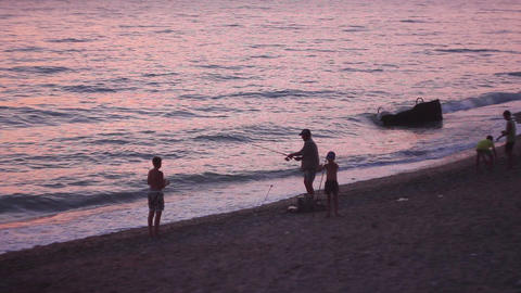 People on the beach at sunset Stock Video Footage