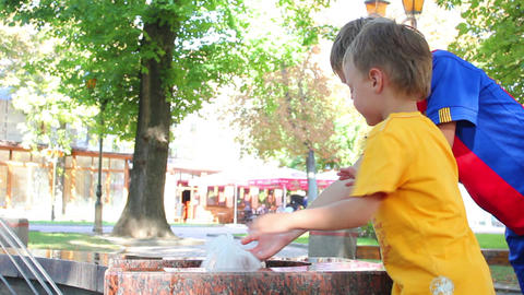 Children at the fountain 1 Stock Video Footage