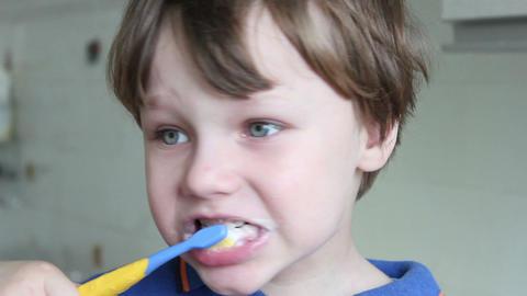 Boy brushing his teeth Stock Video Footage