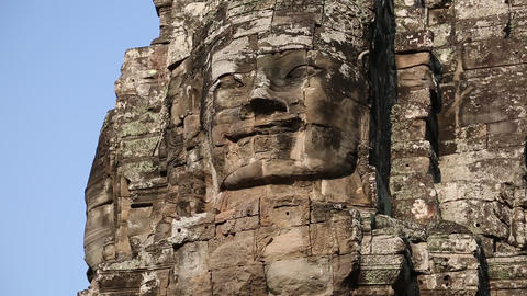 Bas-relief of the face in Bayon - ancient Khmer temple in Angkor Thom temple com Footage