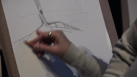 The artist paints a picture of a pencil. 4K Footage