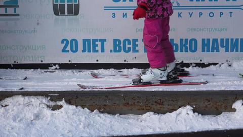 Skis, ski boots, legs. 4K Footage