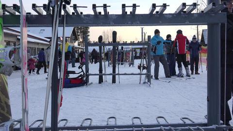 Skis, ski boots, legs. 4K Live Action