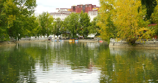 4k Potala Reflection On Lake In Lhasa Park,Tibet.lake With Tree In Autumn stock footage