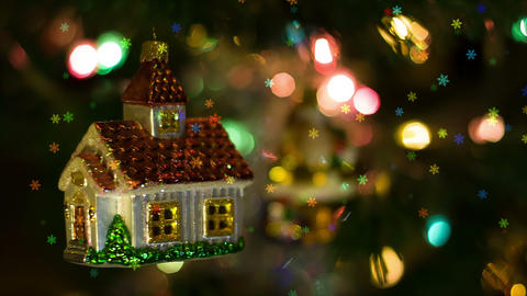 House toy rotates on the New Year Tree and snowfla Footage