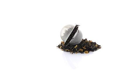 Black dry tea with petals Footage