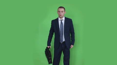 business man waiting with laptop bag green screen ภาพวิดีโอ
