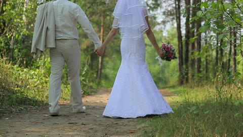 The Bride And Groom Walk In The Woods stock footage