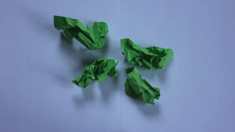 Stop Motion Green Paper Opening stock footage