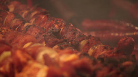 Shish Kebab And Sausages Are Fried At Street Fair stock footage