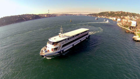 Aerial of a pleasure yacht sailing through Bosporu Footage