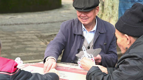 Chinese men plays cards 4075 Footage
