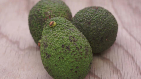 Whole Avocados on Wood Dolly Footage
