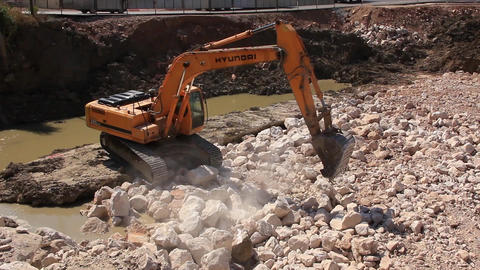 Big excavator operation in stone quarry Footage