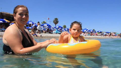 Summer holiday at the seaside. Mother with daughter Footage