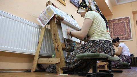 Carpet weaving. Turk womans making a silk carpet Footage