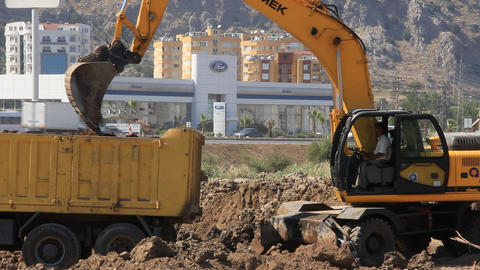 Yellow excavator and dumper truck Footage