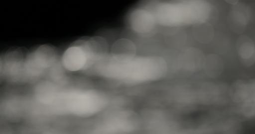 4K, Water Bokeh Effects Created By Breakers stock footage