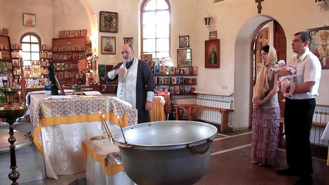 Christening of little baby in orthodox church. Infant baptism Footage