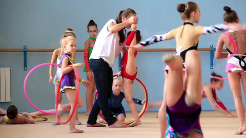 Girls gymnasts having training in gym before examination in Deriugina school Footage