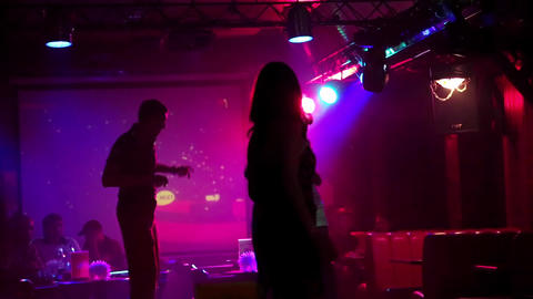 Young people dancing on the dance floor in night club Live Action