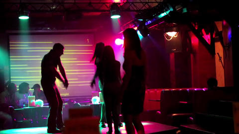 Young people dancing on dance floor in night club Live Action
