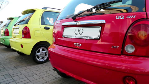 Multicoloured cars Chery QQ at motor show Footage