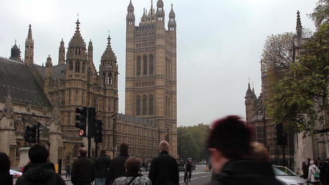 Road traffic near Houses of Parliament in London, England Footage