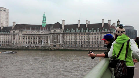 People on the Westminster bridge in London, England Live Action