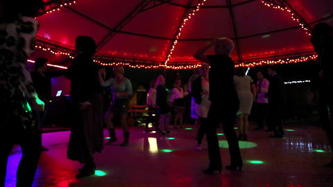 People dancing on dance pavilion Footage