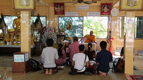 People inside Buddhist temple on Pratumnak Hill by Golden Buddha statue, Pattaya Footage