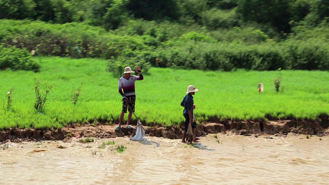 Fishermans on the riverbank of Tonle Sap lake in Siem Reap province, Cambodia Footage
