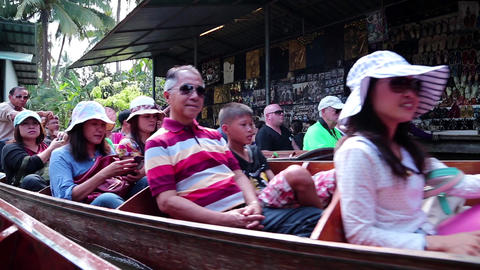 People in boats at the floating market near Bangkok in Thailand Footage