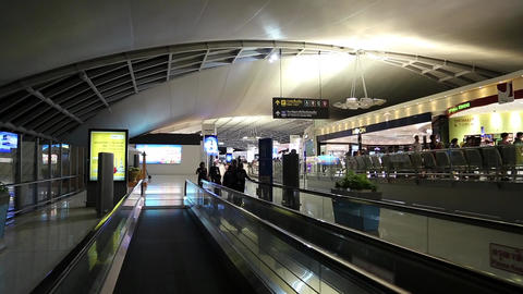 People On Travelator Inside International Airport In Bangkok, Thailand stock footage