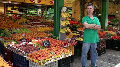 People near shop counter with fresh fruits on the market place Footage