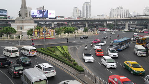Road traffic near Victory Monument in Bangkok, Thailand Footage