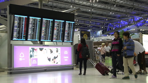 People near information board in international airport in Bangkok, Thailand Footage