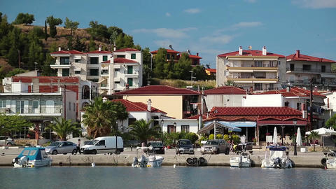 Cars and boats in harbour in Nea Skioni village in Greece Footage