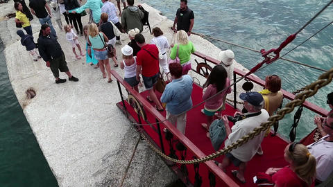 People walk the gangway of ship Footage