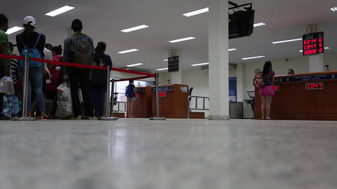 People at passport checkpoint at Thailand-Cambodia state frontier Live Action