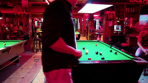 People playing billiards in billiards club in Pattaya, Thailand Footage