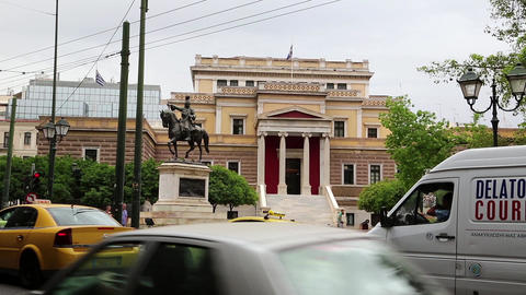 Road traffic near statue of General Theodoros Kolokotronis and old parliament ho Footage