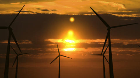 Set Of Wind Generators Against Dawn - 4K stock footage