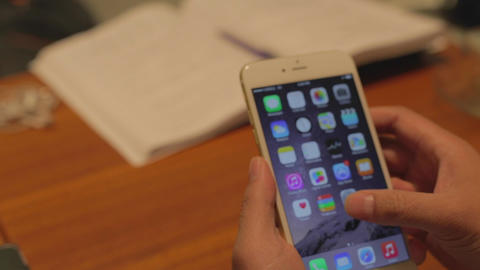 iphone 6 plus - businessman scrolls screen and ope Footage