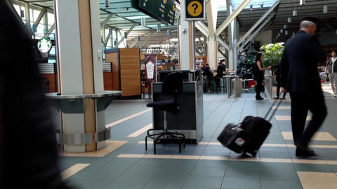 Passengers with luggage inside YVR airport in Vanc Footage