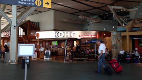 People with luggage in front of Koho restaurant an Footage